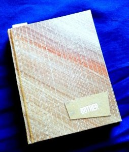 Hand bound book covered with paste-paper