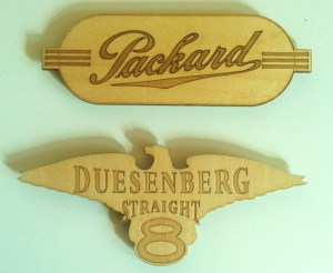 "Packard and Duesenberg magnets, cut from 1/8"" birch plywood."