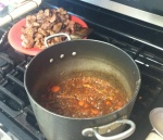 Vegetables simmering with beer. Meat waiting to dive in.